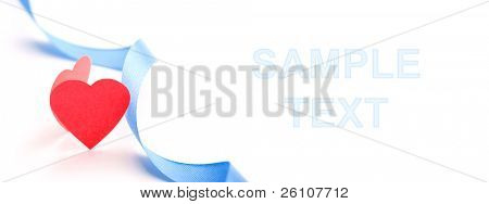 Red paper heart with blue silk ribbon isolated on white. Closeup. Celebratory and easy editable image.
