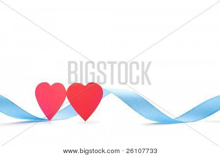 Two red paper hearts with blue silk ribbon isolated on white. Closeup. Celebratory image.