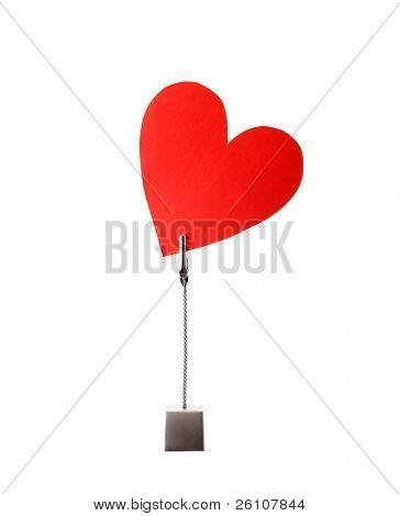 Red paper heart in cardholder. Isolated over white background.