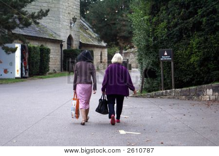 Two Women/ Friends Going Out Together