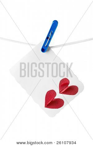 Blank handmade card with two hearts hanging on the clothesline. Isolated on white background.