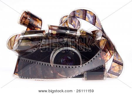 old photo camera with film on white background