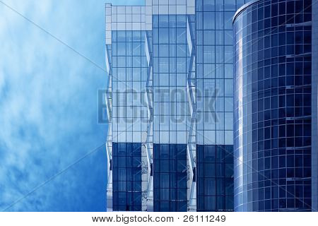 business buildings on blue sky and clouds