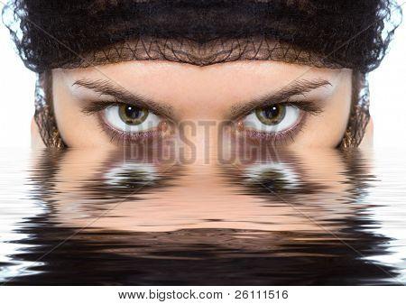 Arabian woman close-ups green eye look on white background