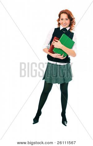 Young beautiful student girl with books in hand on white background