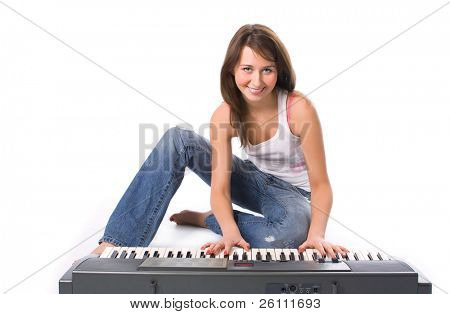 pretty girl to play the piano over white