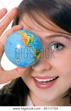 yung beauty girl hold globe in front of eye over white