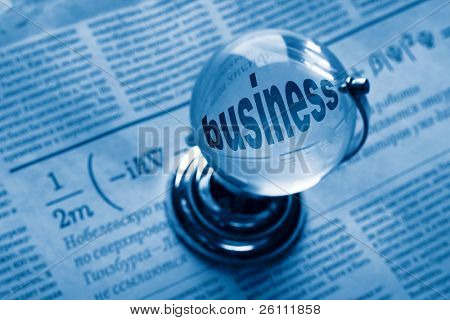 globe and formula of business on newspaper