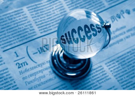 globe and formula of succes on newspaper