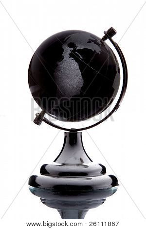 black globe with white continent over white background with reflection