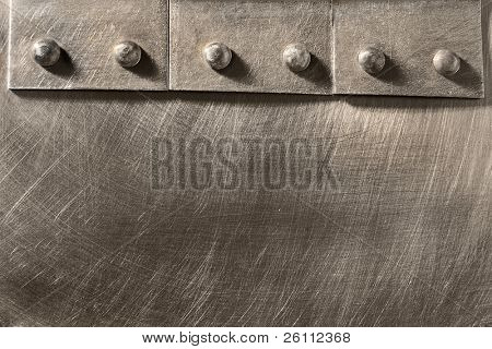 riveted seam on the metal scratched sheet