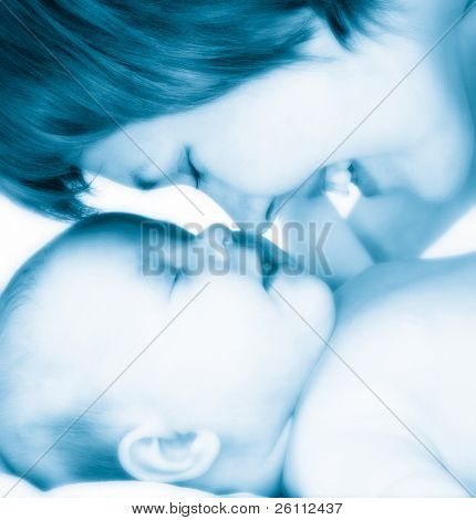 mother with new born baby in blue