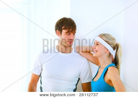 Portrait Of Handsome Guy And Pretty Girl In Sportswear