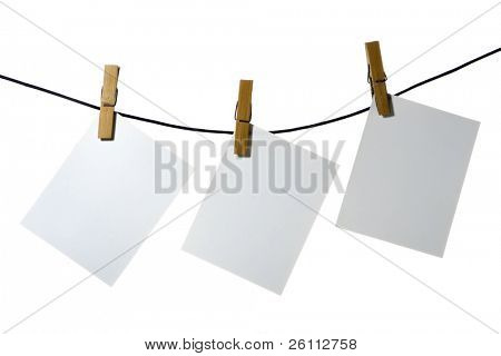 white paper clothes-peg rope over white background