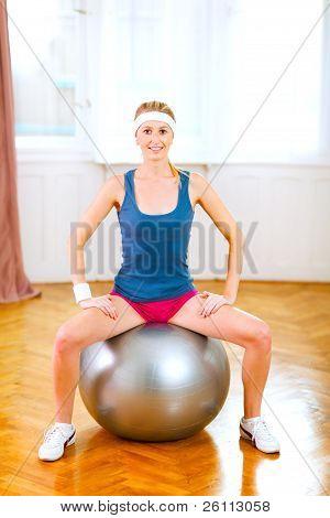 Slim Girl In Sportswear Sitting On Fitness Ball