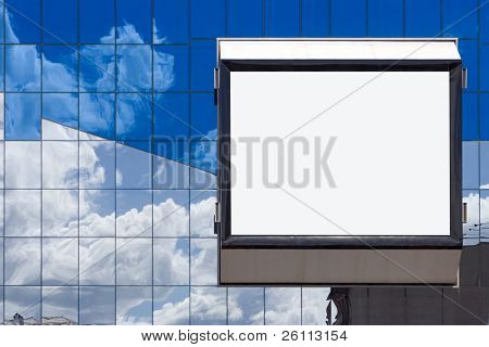 white bill board advertisement in glass brick wall in business building