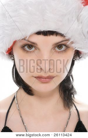 close-up portrait beauty christmas girl in red cap over white background