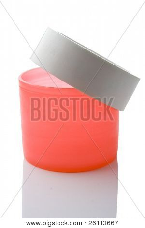 red plastic can over white