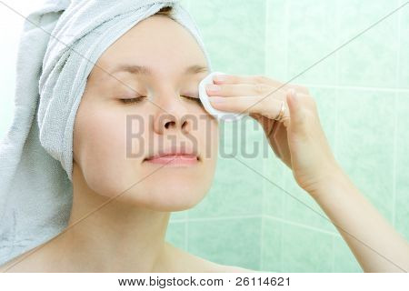 Pretty young woman with tampon in bath room