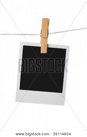 old photo frame palaroid attach to rope clothes peg over white background