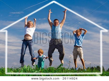 jump happy family mother father and two child. home of dream under blue sky