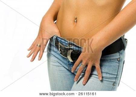 sexy  woman tan belly in jeans with belt isolated over white background