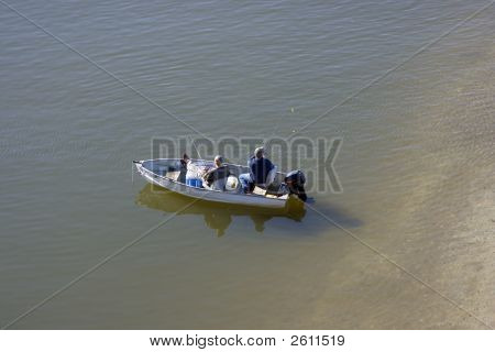 Two Fishermen In A Boat