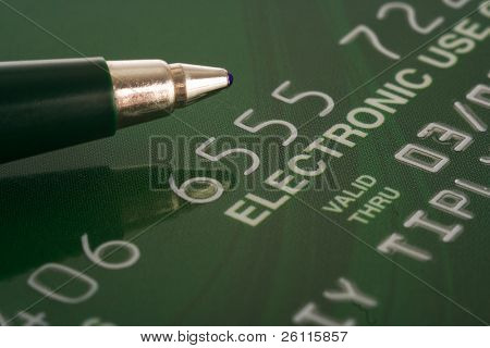 credit card with pen financial background