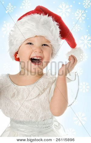 pretty baby in santa claus christmas red hat and snowflake on blue