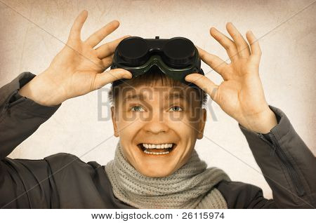 old photo of smiling man with sun glasses