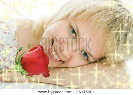 close-up woman face with rose flower and starlet