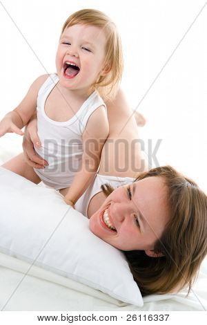 mather and baby in bed