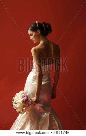 Beautiful Bride With Bouquet On Red Background