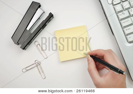 Woman Writing On Sticker In The Office