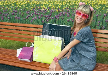 beauty shopping blonde girl with paper bag