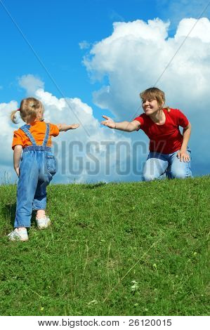 mother delay hand daughter help go up hillock