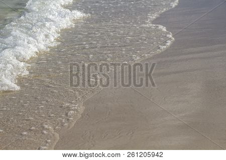poster of Sea Water Tide On White Sand Beach. Smooth Sea Wave On Smooth Sand. Tropical Seaside Photo. Summer V