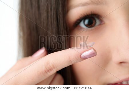 beautiful human eye and contact lens on white background