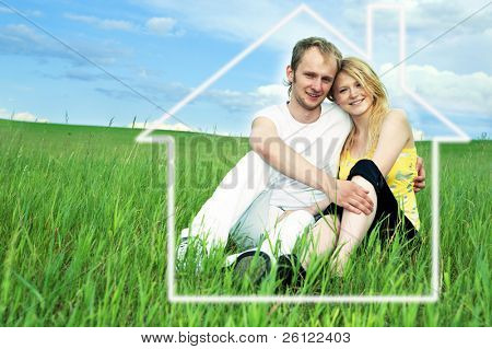 man and woman in house on green field  under blue sky