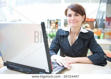 young business woman work on laptop in interiors