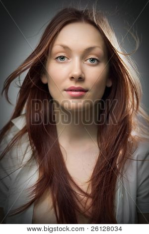 beauty redheaded woman portrait on gray background