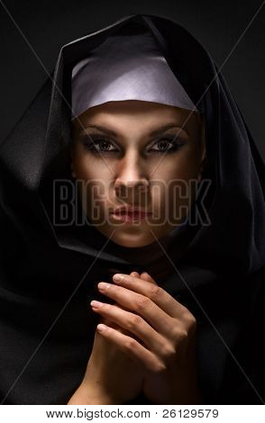 Portrait of a young woman nun in hood