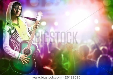 young beauty woman with guitar on concert