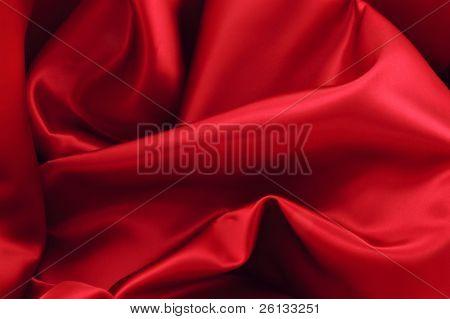 Trozo de tela de Satén roja lujosa adecuada para un fondo con textura