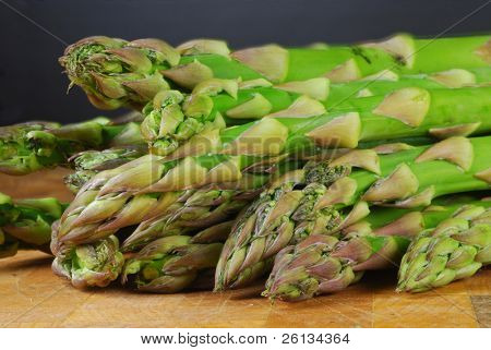 Bunch of fresh asparagus on a cutting board