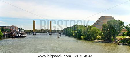 Landmarks of Sacramento, California: Delta King Riverboat, I Street Bridge, Sacramento River and the Ziggurat Pyramid Building.