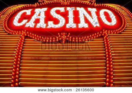 Yellow and red neon lights surround casino sign