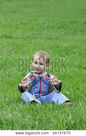 happy baby boy on natural background