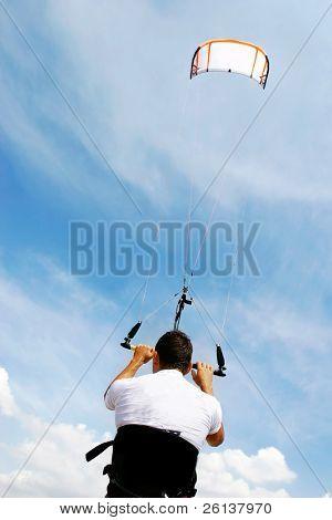 kitesurfer and his kite at sky background