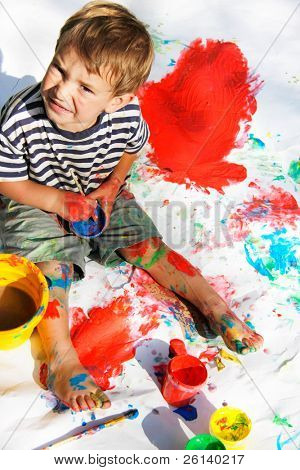 cute boy painting over white